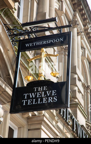 Exterior sign for the public house The Twelve Tellers including the scales of justice part of the Wetherspoon chain Preston Lancashire June 2018 - Stock Image