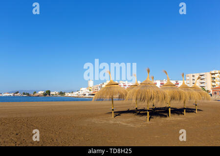 Playa de la Isla Puerto de Mazarron Murcia Spain with parasols and sunshades, one the beaches in the town - Stock Image