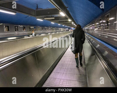 Moving sidewalk in the Stockholm subway that connects the blue line with the red and green lines at the central station. - Stock Image