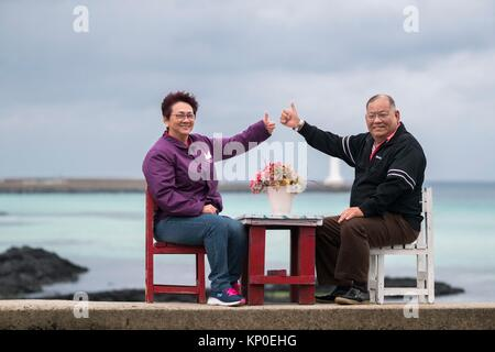 Happy couple at Jeju Gimnyeong Seongsegi beach, Korea - Stock Image