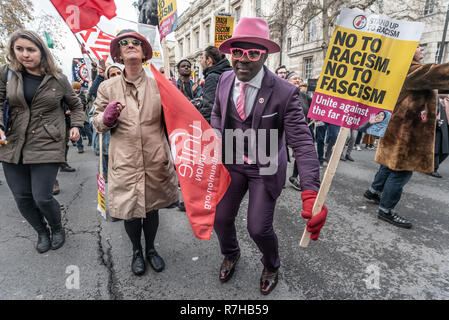 London, UK. 9th Dec, 2018. People dance at the rally by united anti-fascists in opposition to Tommy Robinson's fascist pro-Brexit march. The march which included both remain and leave supporting anti-fascists gathered at the BBC to to to a rally at Downing St. Police had issued conditions on both events designed to keep the two groups well apart. Credit: Peter Marshall/Alamy Live News - Stock Image