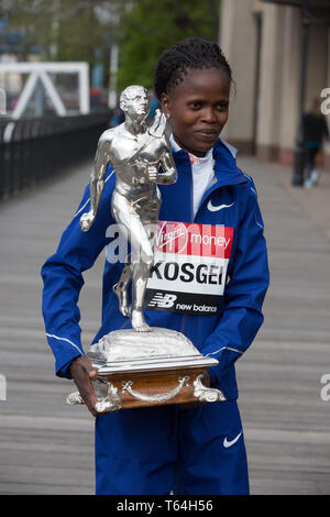 London,UK,29th April 2019,The London Marathon Winners photocall took place outside the Tower Hotel. Kenyan Brigid Kosgei posed with a trophy.Credit: Keith Larby/Alamy Live News - Stock Image