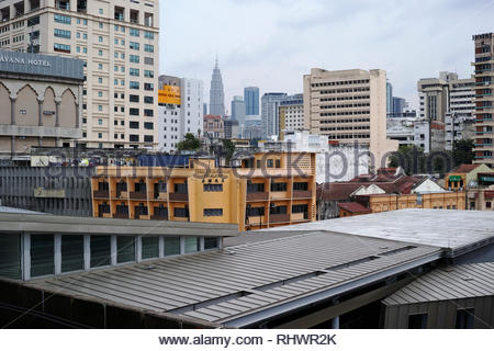 Rooftops and buildings of Kuala Lumpur viewing the Petronas Twin Towers: Malaysia. - Stock Image