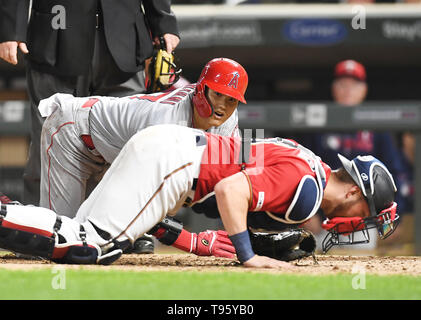Los Angeles Angels designated hitter Shohei Ohtani gives an anxious look to Minnesota Twins catcher Mitch Garver after being tagged out at home plate in the eighth inning during the Major League Baseball game at Target Field in Minneapolis, Minnesota, United States, May 14, 2019. Credit: AFLO/Alamy Live News - Stock Image