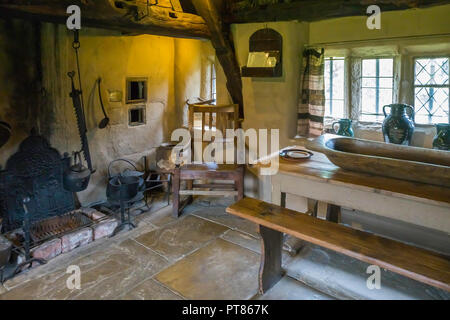 Living Room in Stang End a 17 century Cruck house  at the Ryedale Folk Museum in Hutton le Hole North Yorkshire England UK - Stock Image