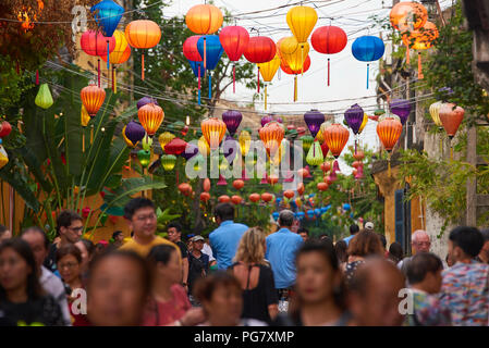 The UNESCO protected town of Hoi An decorates their streets with traditional chinese style lanterns. At night, tourists place candles in small paper c - Stock Image