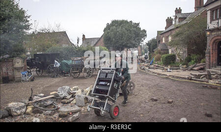 Great Budworth, UK. 11th April, 2018. Film crew on set in the new BBC drama 'War Of The Worlds' by HG Wells, filmed in the streets of Great Budworth v - Stock Image