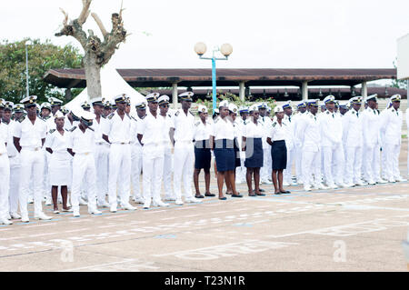 Abidjan, Ivory Coast - August 3, 2017: Epaulets ceremony for students leaving the Maritime Academy. sailor soldiers dressed in white and blue standing - Stock Image