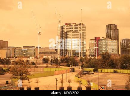 London ,UK, 16th October 2017. Buildings at the International Quarter, Westfield Stratford, lit up against the orange - Stock Image