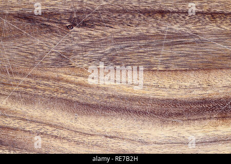 Vintage wooden cutting board with scratches. Image shot from above in flat lay position. - Stock Image