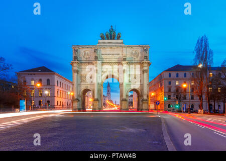 Siegestor, Victory Gate at night, Munich, Germany - Stock Image