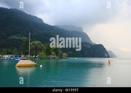 Rainy summer day at the shore of Lake Brienz, Switzerland. - Stock Image