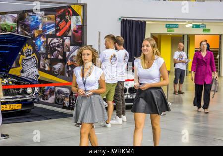 Bielsko-Biala, Poland. 12th Aug, 2017. International automotive trade fairs - MotoShow Bielsko-Biala. Girls walking through the hall with leaflets in hands. Credit: Lukasz Obermann/Alamy Live News - Stock Image