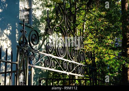 A decorative iron gate on a historic home along Lagare Street in Charleston, South Carolina. - Stock Image