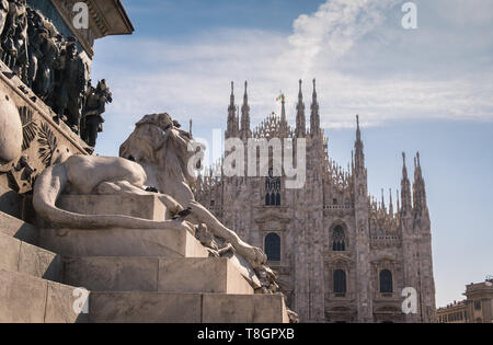 Piazza del Duomo, featuring sections of Victor Emanuele II monument and Milan Cathedral (Duomo), Milan, Lombardy, Italy. - Stock Image