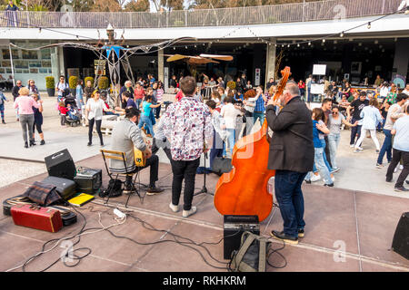Swing band playing, Crowd dancing on music, Muelle uno, Malaga port, Andalusia, Spain. - Stock Image