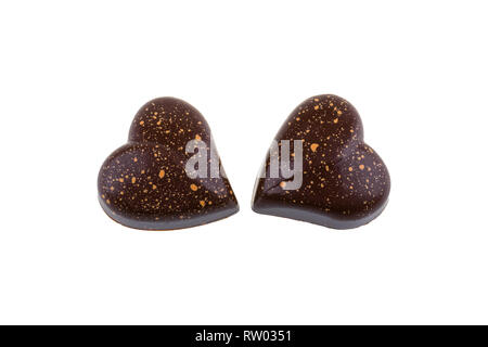 Chocolate candies in shape of heart isolated on white background. - Stock Image