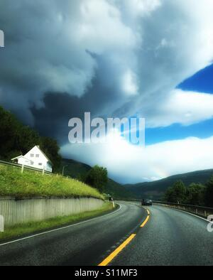 Dark clouds meets rainbow - Stock Image