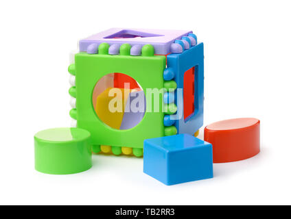 Plastic shape sorter cube and blocks isolated on white - Stock Image