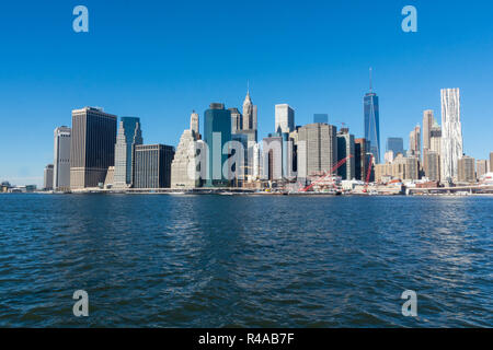 Manhattan Island, NYC seen from Brooklyn on a sunny winter day with a clear blue sky - Stock Image