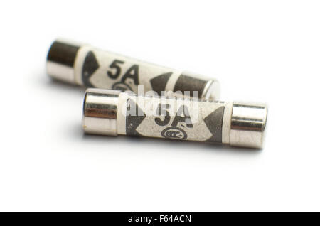 UK Domestic plug 5A fuses on a white background. - Stock Image