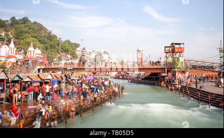 Hundreds of Hindu people are doing the holy bath in the sacred Ganges River in Haridwar. - Stock Image