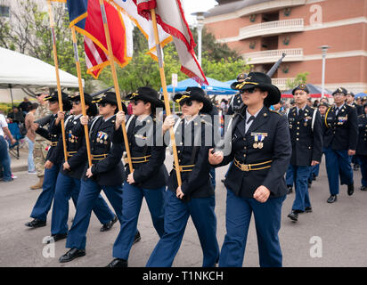 High school Junior ROTC (Reserve Officer Training Corps) cadets march in formation during annual Washington's Birthday Celebration parade, Laredo TX - Stock Image