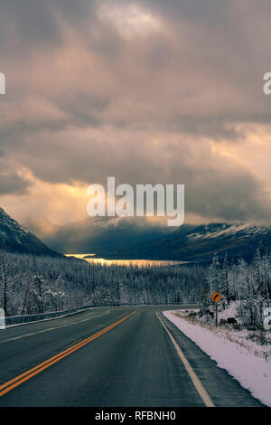 Winter storm over St Marys Lake and U.S. Route 89. Glacier National Park Montana. - Stock Image
