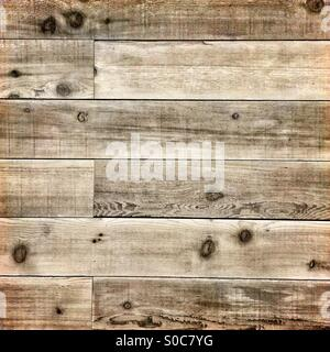 Wooden planks with a lightly distressed, grungy, reclaimed look. - Stock Image
