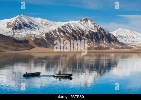 Greenland. Kong Oscar Fjord. Dream Bay. Zodiacs on still water. - Stock Image