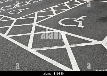 Disabled parking space or bay reserved for people with disabilities and extra space for loading a wheelchair - Stock Image