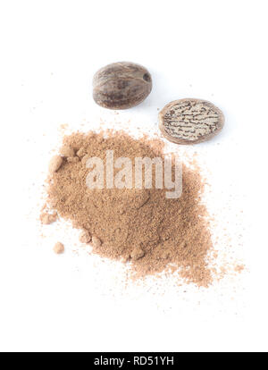 Organic nutmeg and ground nutmeg isolated on white background. - Stock Image