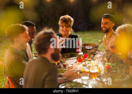 Friends enjoying dinner garden party - Stock Image