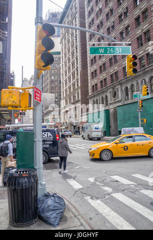 New York City Street with Traffic Lights, Iconic NY Taxi Cab, Street Sign & Garbage Can - Stock Image