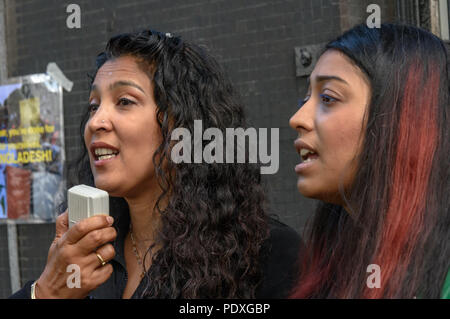 London, UK. 10th August 2018. Campaigners sing at the Bangladesh High Commission in London, where relatives and friends, including a number of his relatives and several well-known photographers, called for the immediate release of Shahidul Alam, seized from his house by police on Sunday shortly after he gave an interview to Al Jazeera over Skype on the road safety protests in Bangladesh. k into custody after the hosp Credit: Peter Marshall/Alamy Live News - Stock Image