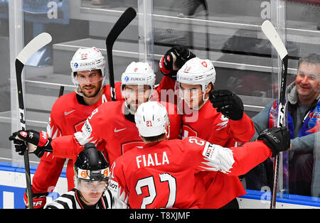 Bratislava, Slovakia. 15th May, 2019. The author of the second goal Nico Hischier (CH), right, celebrates with his teammates in the match between Switzerland and Norway within the 2019 IIHF World Championship in Bratislava, Slovakia, on May 15, 2019. Credit: Vit Simanek/CTK Photo/Alamy Live News - Stock Image