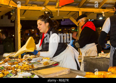 30 November 2018 A busy french Style crepe stall at the Belfast Christmas Fair. Located in a wooden booth this is a popular attraction. - Stock Image