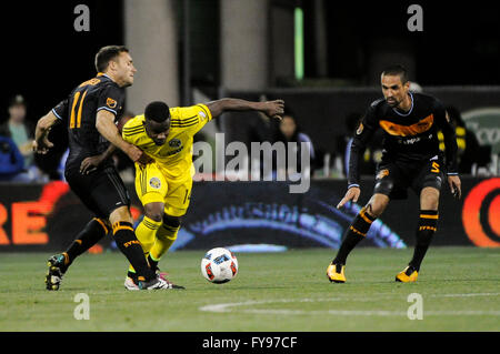Mapfre stadium, USA. 23rd April, 2016. .Columbus Crew SC defender Waylon Francis (14) gets tangled up with Houston - Stock Image