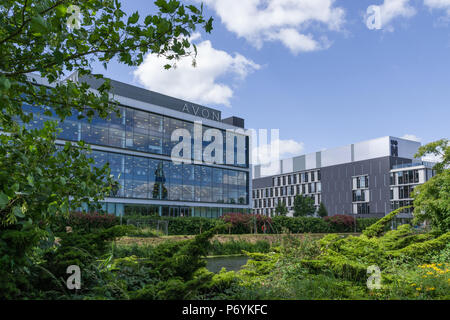 Headquarters of Avon Cosmetics located by the River Nene, Northampton, UK; the University of Northampton to the right. - Stock Image