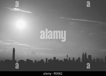 Black and white image of Kuala Lumpur city skyline in the evening sunlight. Tourism concept - Stock Image