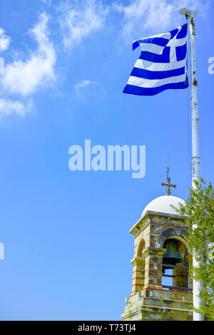 National symbol of Greece, blue-white greek flag on flagpole and blue sky, copy space - Stock Image