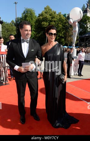 Karlovy Vary, Czech Republic. 28th June, 2019. Actor Martin Dejdar and his wife Daniela Dejdarova arrive to the opening ceremony of the 54th Karlovy Vary International Film Festival begins on June 28, 2019, in Karlovy Vary, Czech Republic. Credit: Katerina Sulova/CTK Photo/Alamy Live News - Stock Image