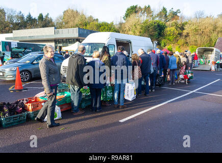 Skibbereen, West Cork, Ireland, December 22nd 2018. A fine sunny day helped the shoppers queue to get the freshest sprouts from the farmers market. Credit: aphperspective/Alamy Live News - Stock Image