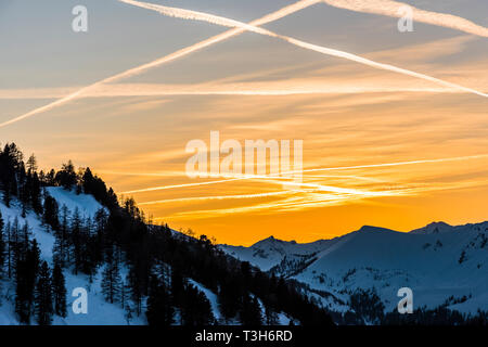 Orange skies at sunset over the mountains in Obertauern, Austria - Stock Image