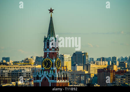 MOSCOW, AUGUST 8, 2018: Closeup view of Spassky – Savior's – tower of Moscow Kremlin and Moscow city at summer sunset. Horizontal photo - Stock Image