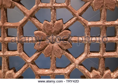 Close up of the pattern in a stone screen which was used in Indian architecture to regulate light or the flow of air. The piece is seen in the exhibit - Stock Image