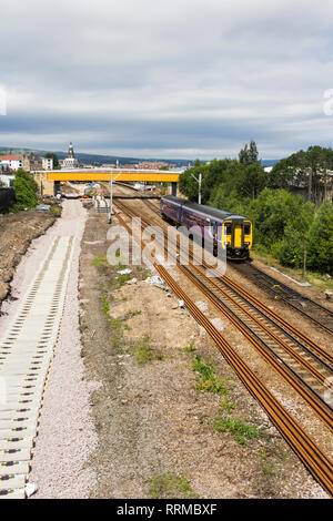 Class 156 diesel multiple unit train leaving Bolton. bound for Manchester Victoria as new railway track is being laid. - Stock Image