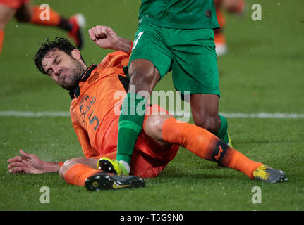 Beijing, China. 24th Apr, 2019. Buriram United's Andres Tunez (L) tackles Beijing Guoan's Cedric Bakambu during during the group G match between China's Beijing Guoan FC and Thailand's Buriram United at the 2019 AFC Champions League in Beijing, capital of China, April 24, 2019. Credit: Ding Xu/Xinhua/Alamy Live News - Stock Image