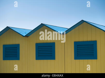 Yellow and blue beach huts in Sestri Levante, Liguria, Italy - Stock Image