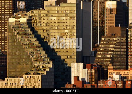 The Mercedes House apartment complex building with its zigzag shape and terraces at sunset. Midtown West, Manhattan, New York City, USA - Stock Image